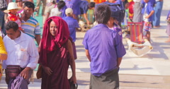 Diverse Buddhist pilgrims walk to pay respect to sacred Golden Rock pagoda Stock Footage