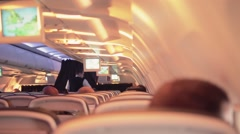 Flight cabin passengers with sunlight reflection - 1080p - stock footage