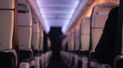 Flight cabin seats with passengers - 1080p - stock footage