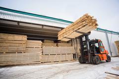 Folk lift truck in wood factory Kuvituskuvat