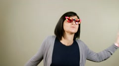 Girl in sunglasses dancing in studio Stock Footage
