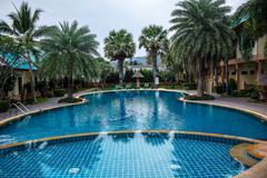 Residential inground swimming pool in backyard - stock photo