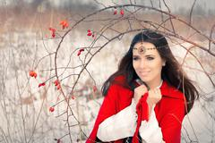 Winter Princess with Rosehip Branch - stock photo