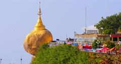Majestic Buddhist pagoda Golden Rock and crowds of local tourists Stock Footage