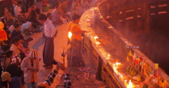 Buddhist pilgrims pray and light candles worshiping on Golden Rock site Stock Footage