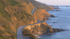Big Sur, Pacific Coast Highway, from above at sunset (pan) Stock Footage