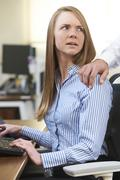 Businessman Sexually Harassing Female Colleague Stock Photos