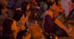 Burmese Buddhist pilgrims worship near altar of Golden Rock in Myanmar Stock Footage
