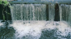 Water flows under pressure at hydroelectric dams in slowmotion Stock Footage