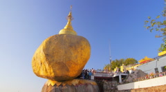 Burmese tourists on holy Buddhist place Golden Rock in Myanmar Stock Footage