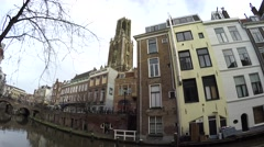 Dom Tower sound and footage of typical dutch canal houses in Utrecht 4k Stock Footage