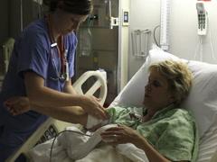 Nurse Helping Patient In Hospital Stock Footage