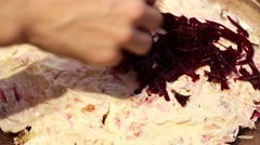 Preparation of traditional Russian salad - herring under a fur coat - stock footage
