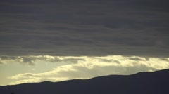 Dark  rain clouds move fast on a dark mountain Stock Footage