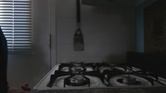 A man warming his hands on a gas stove - stock footage