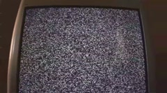 Dolly pullback of a TV with static Stock Footage