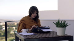 Young female writer receive good news from her publisher during writing book Stock Footage