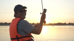 Male fisherman on the boat Stock Footage