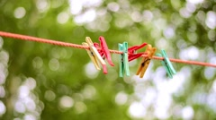 Colorful clothes pins on the rope Stock Footage