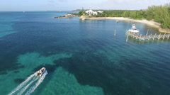 Stock Video Footage of AERIAL: Inflatable Dinghy Cruising Along Coast Bahamas