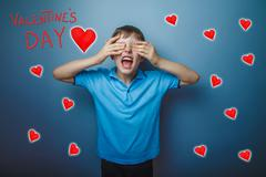 Adolescence boy closed his eyes his hands yelling Valentine's Da Stock Photos