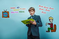 adolescent boy holds a business style tablet media influence zom - stock photo