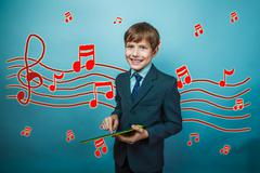 Adolescent boy smiling businessman holding a tablet sketch preve Stock Photos