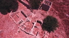 AERIAL: Flying over the abandoned village Souskiou in Paphos District, Cyprus Stock Footage