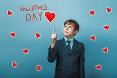 boy businessman adolescence points up Valentine's Day celebratio - stock photo