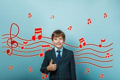 boy Teen showing sign yes Music notes sketch prevent sound - stock photo