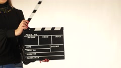 Stock Video Footage of Woman uses movie clapper board, on white