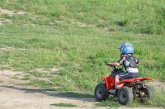 Boy Riding a Quad Bike Stock Photos