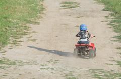 Boy Riding a Quad Bike Stock Photos