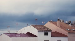 Beautiful sky above colored roofs. Stock Footage
