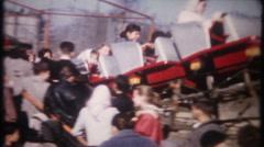 Children ride roller coaster at amusement park - 3128 vintage film home movie Stock Footage