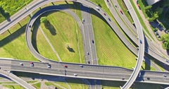 Flying above road interchange in City Stock Footage