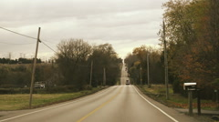 POV Driving up and down a country road Stock Footage