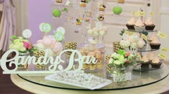Stock Video Footage of Candy bar with cookies and colorful candy on plate for birthday, anniversary