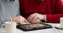 Senior couple browsing photo gallery on their digital laptop. Shot on RED Epic. Stock Footage