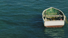 boat  bobbing in the waves in open sea in windy and sunny  day - stock footage