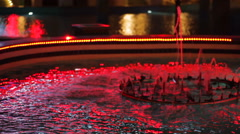 Night swimming pool with red illumination is reflected in water Stock Footage