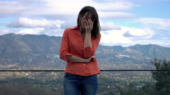 Stock Video Footage of Sad, unhappy woman crying on terrace