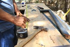 Carpenter working - stock photo