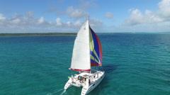 AERIAL: Tropical Paradise Sailboat Sailing Bahamas - stock footage