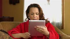 Serious Woman in Pajamas on iPad - stock footage