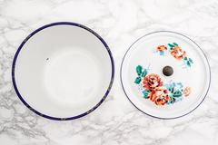 Empty White Vintage Enamel Saucepan with Flower Design - stock photo