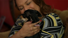 Woman with Little Dog at Home Stock Footage