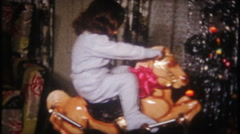 Little girl, rocking horse on Christmas morning - 3135 vintage film home movie Stock Footage
