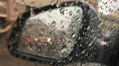 Rain, water drops rolling car window glass side rear view mirror reflection Stock Footage
