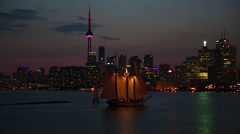 Toronto Skyline at Night in Ontario Canada with Sailboat Stock Video Stock Footage